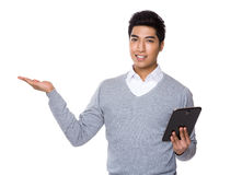 Businessman use of the tablet and open hand palm Stock Photography