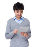 Businessman use of the tablet pc Stock Photo