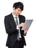 Businessman use of the tablet pc Stock Photography
