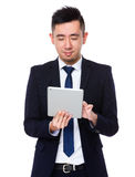 Businessman use of the tablet pc Royalty Free Stock Photo