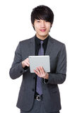 Businessman use of the tablet pc Royalty Free Stock Photography