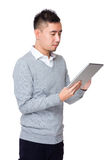 Businessman use of the tablet pc Royalty Free Stock Images