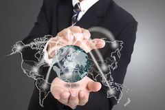 Businessman used hand for cover networking. Around global with digital planning logistic Stock Photos