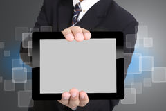 Businessman used hand for hold touch pad Royalty Free Stock Images
