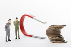 Businessman used large magnet for attracts benefit income Stock Images