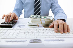 Businessman uses computing device, calculator Royalty Free Stock Images