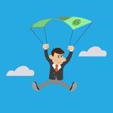 The businessman uses the dollar as a parachute Stock Photos