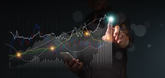 Businessman uses finger point to the top of stock graph. Excellence icon for business, competence, innovation, passion,