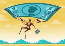 Businessman uses his Financial Dollar Bill Parachute. Royalty Free Stock Image