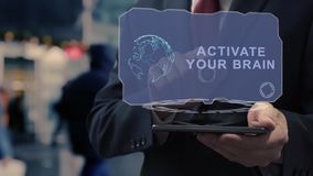 Businessman uses hologram activate your brain
