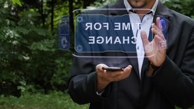 Businessman uses hologram with text Time for change