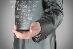 Businessman uses smart phone with virtual envelopes Royalty Free Stock Photos