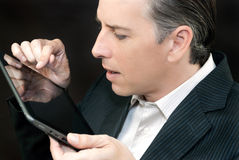 Businessman Uses Tablet, Side Profile Stock Photos