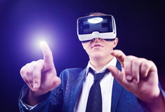 Businessman uses Virtual Realitiy VR head-mounted display. Businessman has fun using his Virtual Realitiy VR glasses head mounted display Royalty Free Stock Images