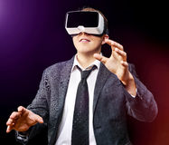 Businessman uses Virtual Realitiy VR head-mounted display Royalty Free Stock Image