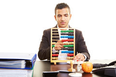 Businessman using an abacus Royalty Free Stock Photography