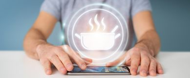 Businessman using application to order home made food online 3D. Businessman on blurred background using application to order home made food online 3D rendering Royalty Free Stock Images