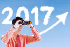 Businessman using binocular outdoors Stock Photography