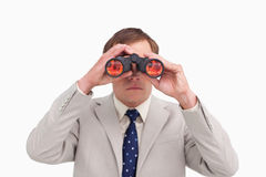 Businessman using binoculars Royalty Free Stock Photo