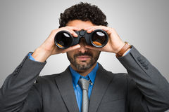 Businessman using binoculars Royalty Free Stock Images