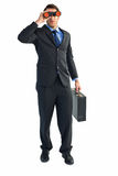 Businessman using binoculars while holding a briefcase Stock Photos