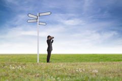 Businessman using binoculars. Stock Images