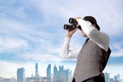Businessman using binoculars. Royalty Free Stock Images