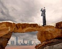 Businessman using binoculars Stock Photography