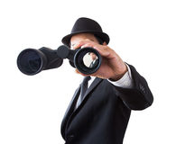 Businessman using binoculars. Stock Photo