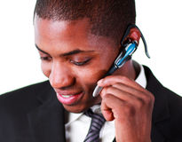 Businessman using an bluetooth earpiece Royalty Free Stock Photography
