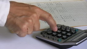 Businessman using calculator. An accountant in white shirt using calculator isolated stock video footage