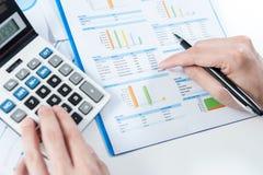 Businessman using calculator analyze report Royalty Free Stock Image