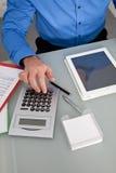Businessman using a calculator royalty free stock photos