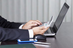 Businessman using a calculator Royalty Free Stock Photo