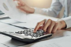 Free Businessman Using Calculator For Calculate Budget On Table In Of Stock Images - 108299304