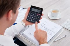 Businessman using calculator Royalty Free Stock Image