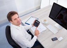 Businessman using calculator Stock Image