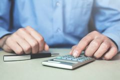 Businessman using calculator in his desk. Business concept Stock Image
