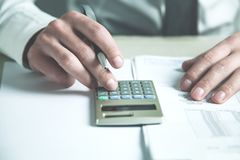 Businessman using calculator in his desk. Business concept Royalty Free Stock Image