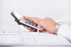 Businessman using calculator in office Stock Photography
