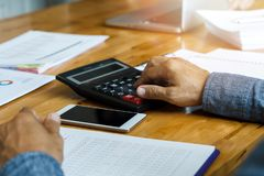 Businessman using calculator to calculate budget,. Business concept stock images