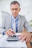 Businessman using calculator to calculate finance Stock Photos
