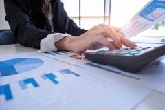 Businessman using calculator to calculate loan plan stock photos