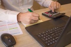 Businessman using a calculator to calculate the numbers. Accounting , Accountancy, Calculation Concept Royalty Free Stock Photos