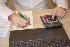 Businessman using a calculator to calculate the numbers. Accounting , Accountancy, Calculation Concept Stock Images