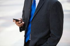 Businessman using cell phone Royalty Free Stock Images