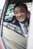 Businessman Using Cell Phone In Car Royalty Free Stock Image