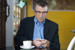 Businessman using a cell phone Stock Photos