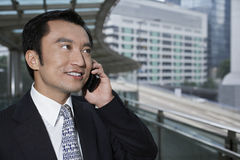 Businessman Using Cell Phone On Footbridge Royalty Free Stock Photography