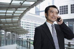 Businessman Using Cell Phone On Footbridge Stock Images